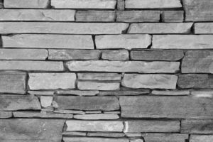 Old brick wall background. Grey stone wall texture, slim briks.